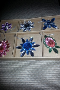 Small costume jewellery style tree ornaments in bright colours