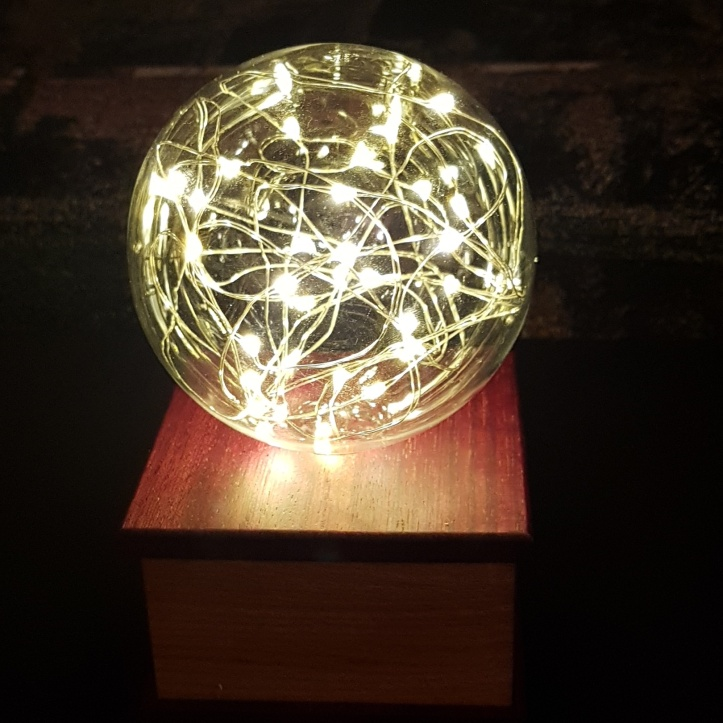 Glass ball with delicate lights inside