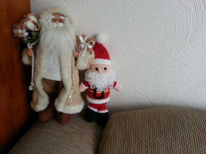 Knitted red Santa and a traditional European Santa