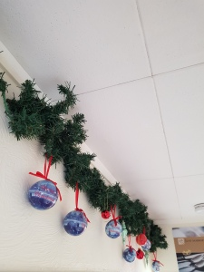 Christmas baubles in blue, featuring Dutch themes such as windmills