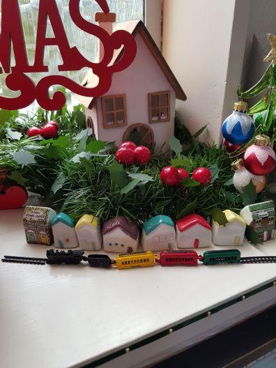 Miniature ceramic houses and tiny train
