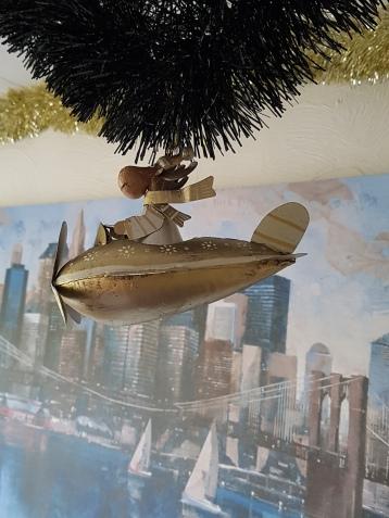 Metal reindeer ornament - flying a plane
