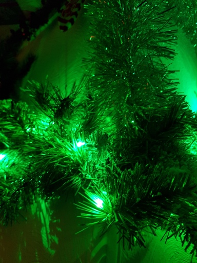 Plush green bough with green lights
