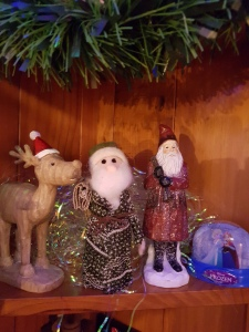Wodden moose wearing a Santa hat, fabric Santa and a wooden Santa