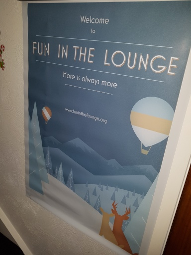 Welcome to Fun in the Lounge poster; More is always more; www.funinthelounge.org. Features mountains, trees, reindeer and hot air balloons