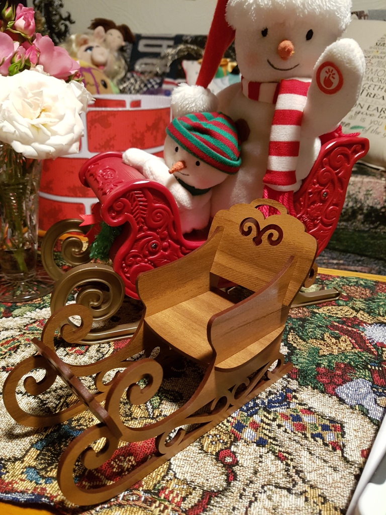 A large sleigh with a couple of snowmen (who sing) and a tasteful wooden sleigh made of wood