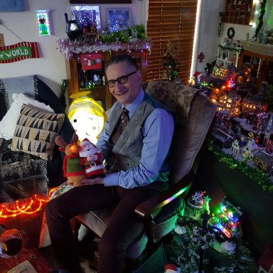 Our friend Jerry sitting with a toy on his lap amid the full on Fun in the Lounge