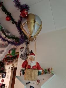Santa - decoration: hot air balloon and Santa in the basket, looking downwards