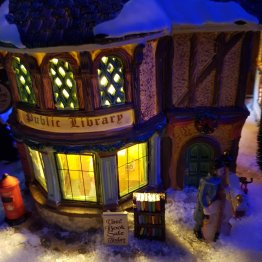 Light up model of a public library; withdrawn books outside