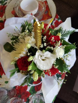 Red and white flowers, gold candle