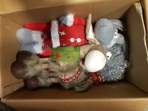 Christmas moose and donkey packed in a box