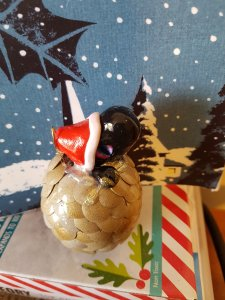 Ornament; baby dragon in Santa hat emerging from egg