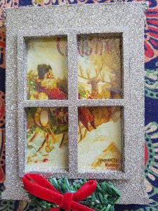 Christmas scene of Santa on a sleigh glimpsed through a glittery window pane