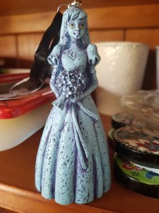 Christmas tree ornament of a ghost from Disney's Haunted Mansion