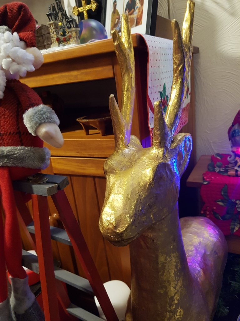 Standing ornament of a gold coloured reindeer