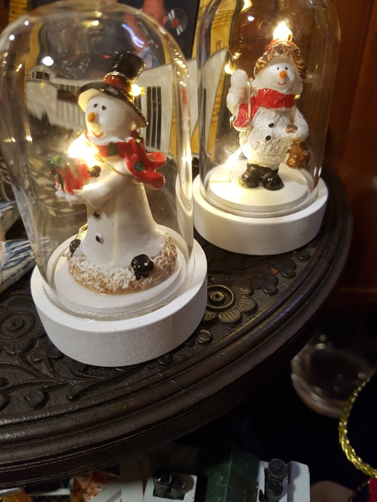 Small light up ornaments; snowman under a dome