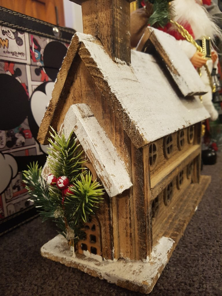 Wooden church ornament covered in snow