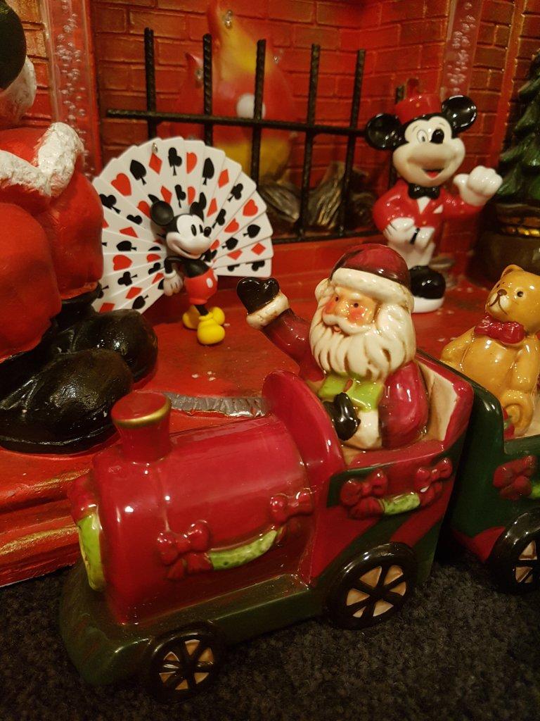 Santa in a train; Mickeys visible behind
