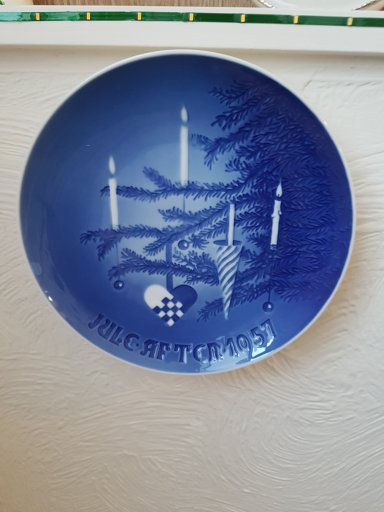 Blue plate featuring Christmas tree branch, decorations and candles