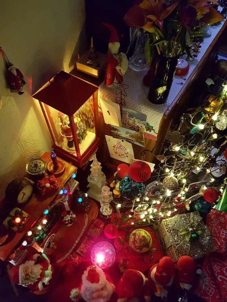 Tree, lights, Santa in a lantern, lit up fireplace