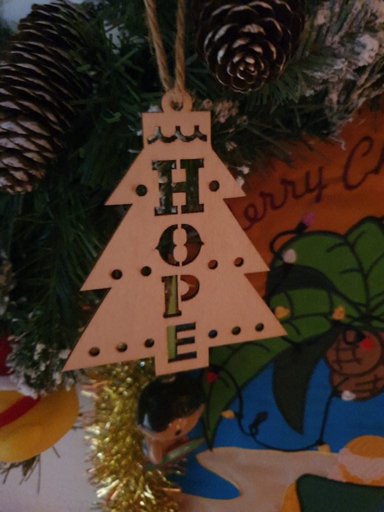 Wooden tree shaped ornament reading HOPE