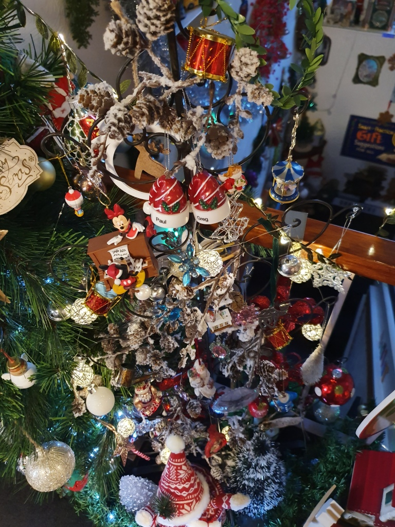 View looking down on a very heavily decorated metal tree - which you cannot really see