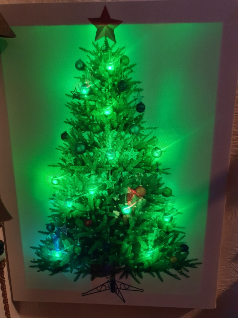 Light up picture of a tree, in shades of green (changes colour)
