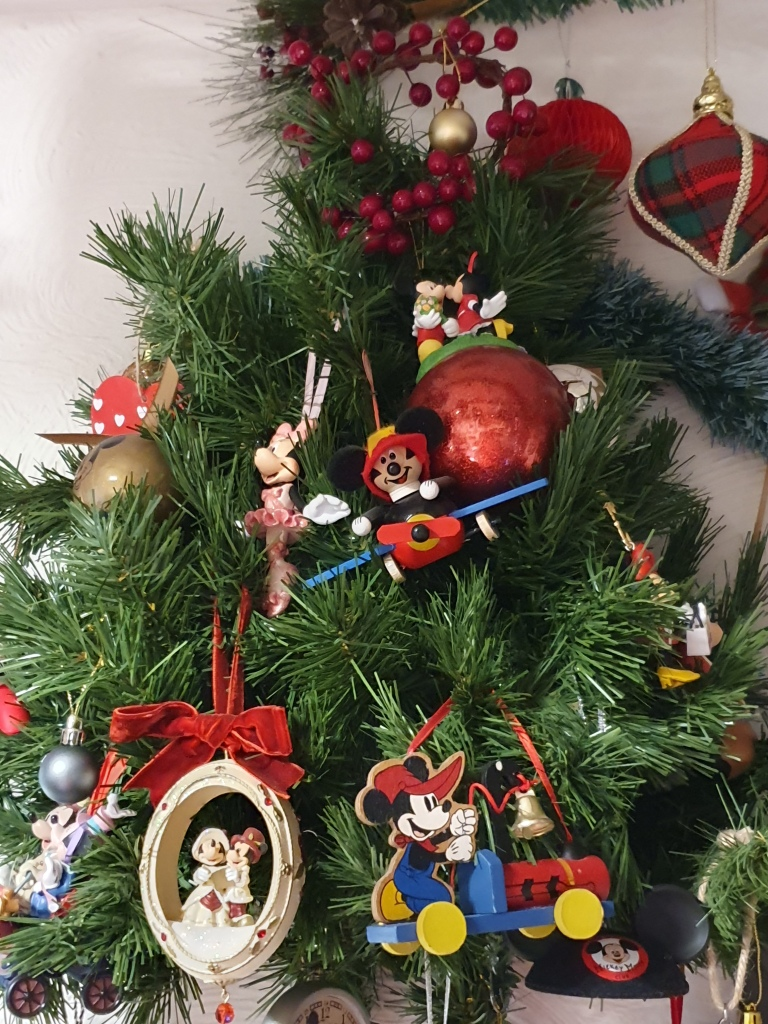 Small tree on the wall featuring Disney ornaments, many Mickey