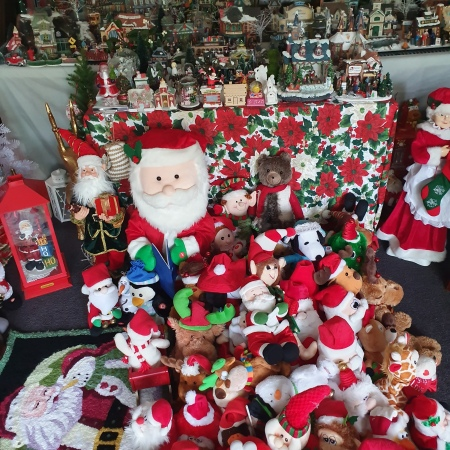 Santas and toys grouped in front of the Village