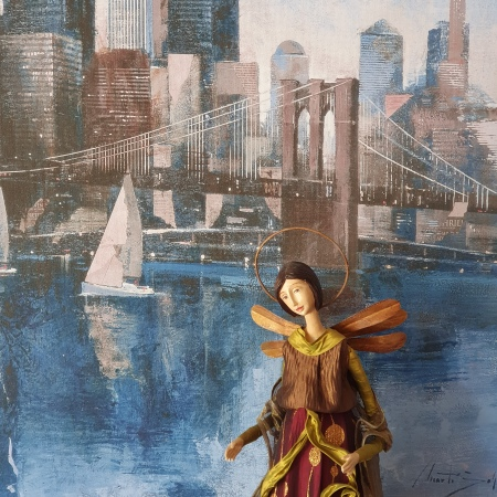 Picture of the Brooklyn Bridge on our wall; large porcelain-faced angel in front