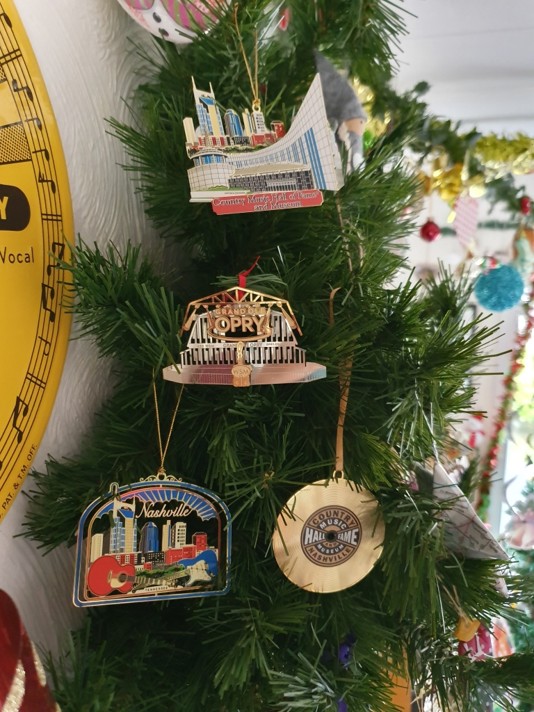 Four souvenir ornaments featuring Nashville in this tree