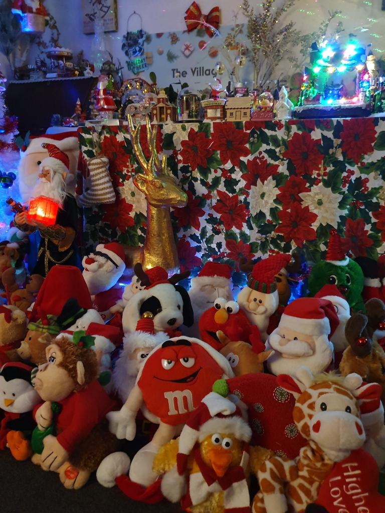 Collection of CHristmas toys, Santas and animals of every sort
