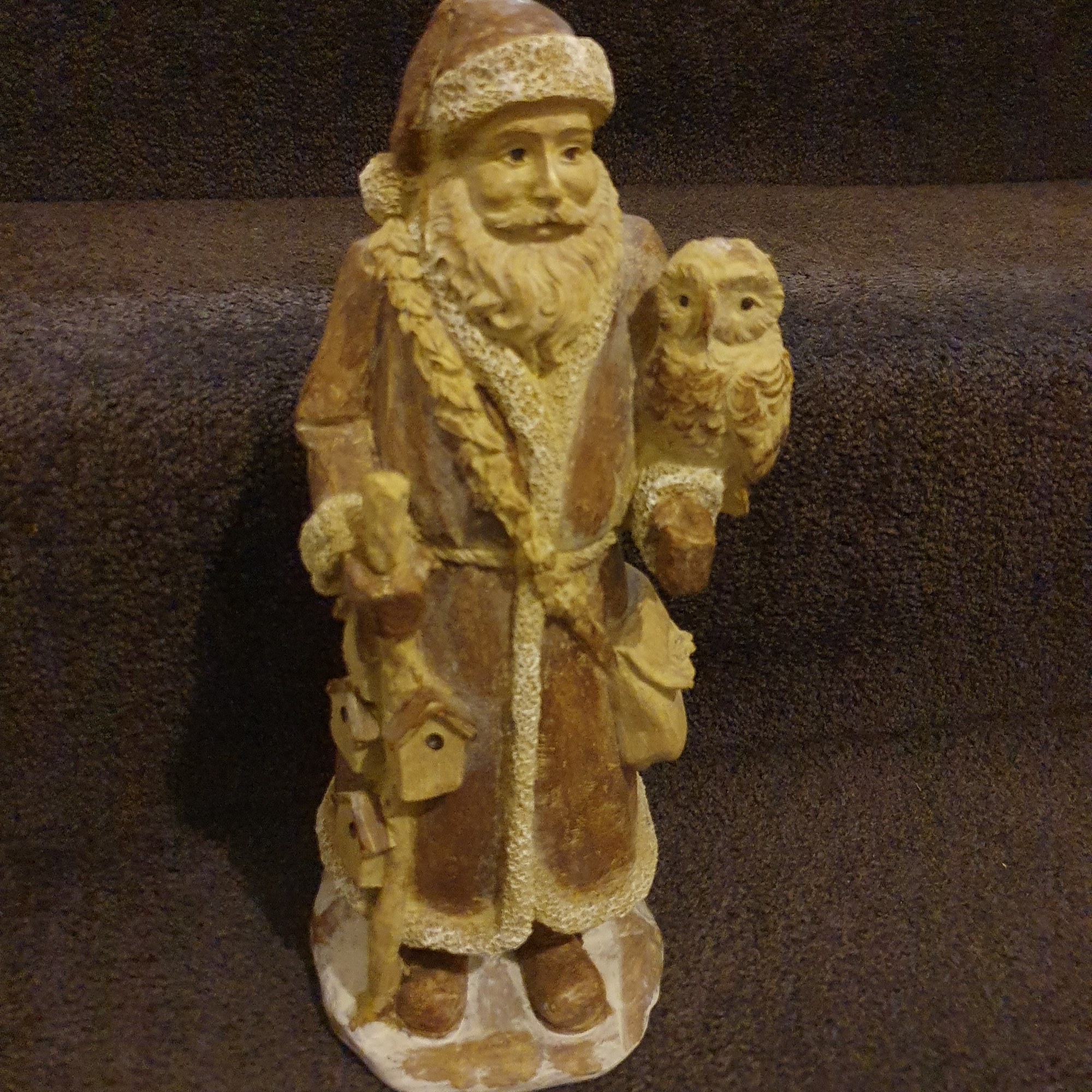 Wooden rustic Santa holding an owl