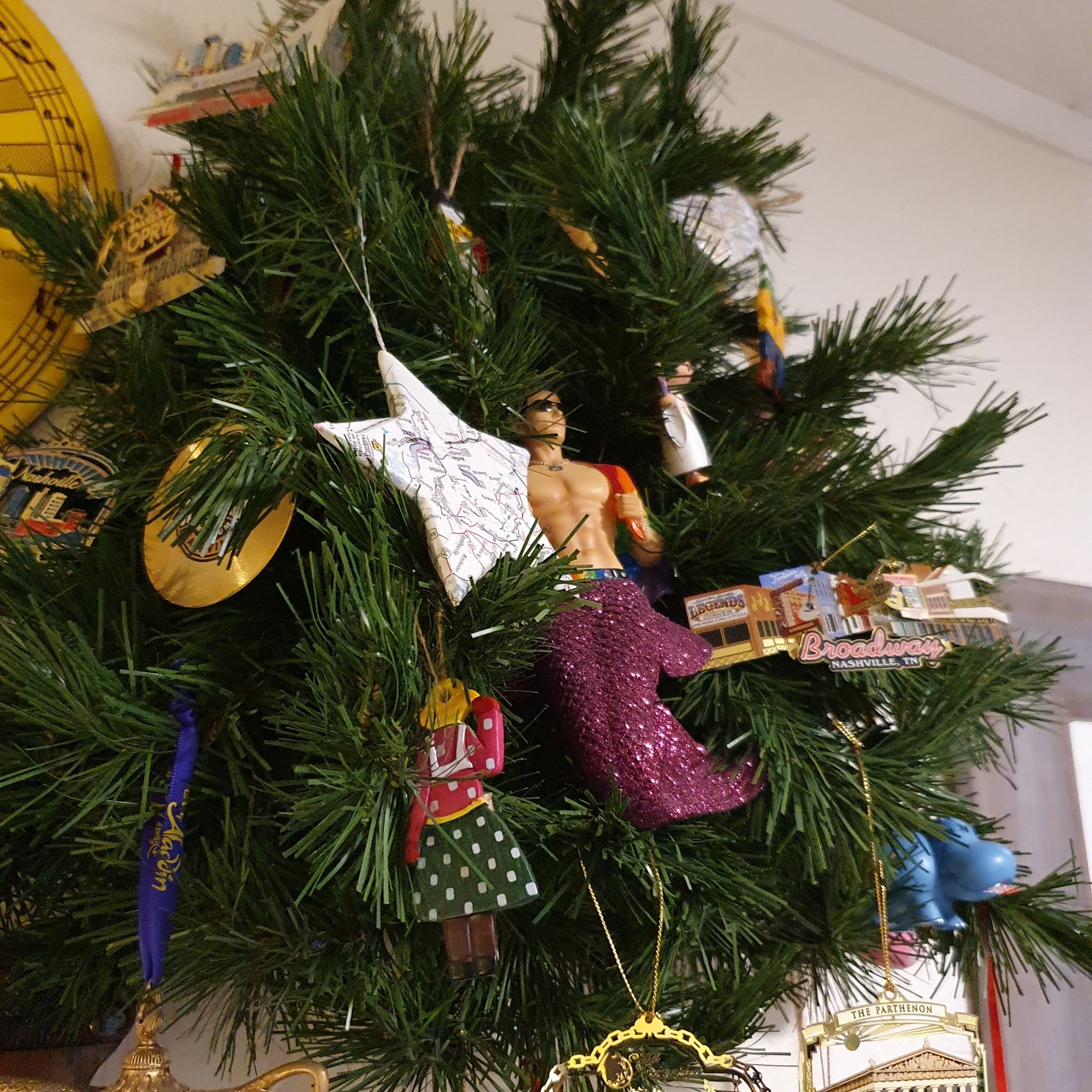 Small tree featuring a range of ornaments from Nashville, some Disney and a handsome merman!