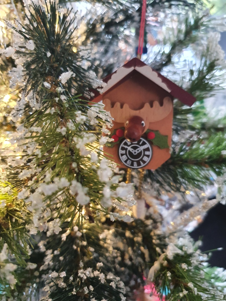 Wooden 'reindeer clock' in the style of a cuckoo clock, tree ornament